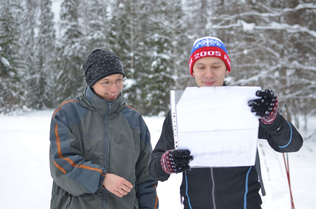 Aleksey and a friend, reviewing a map of their ski route, near Perm, Russia.