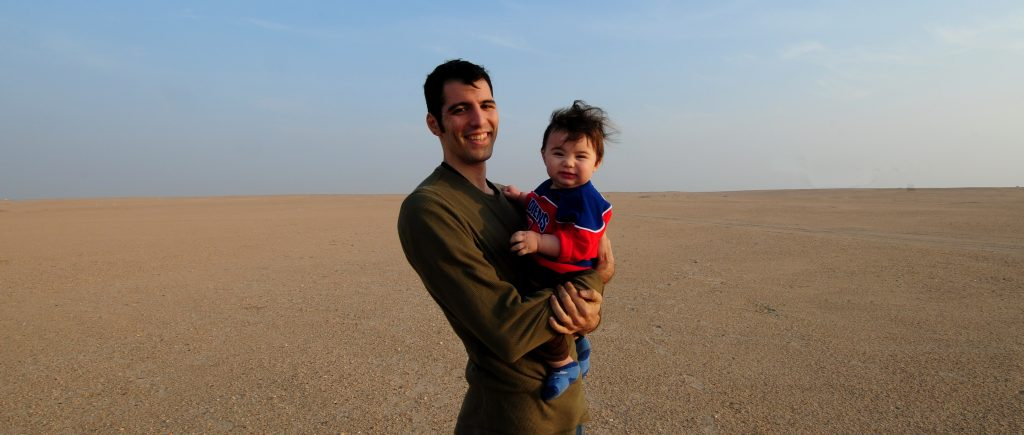 Adriano and his son, at a weekend desert barbecue, in Kuwait.