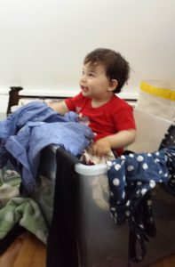 "My son, ""helping out"" with the clothes declutter."