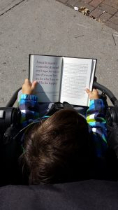 "My son Zeno reading ""Self-Reliance"". Starting him young!"